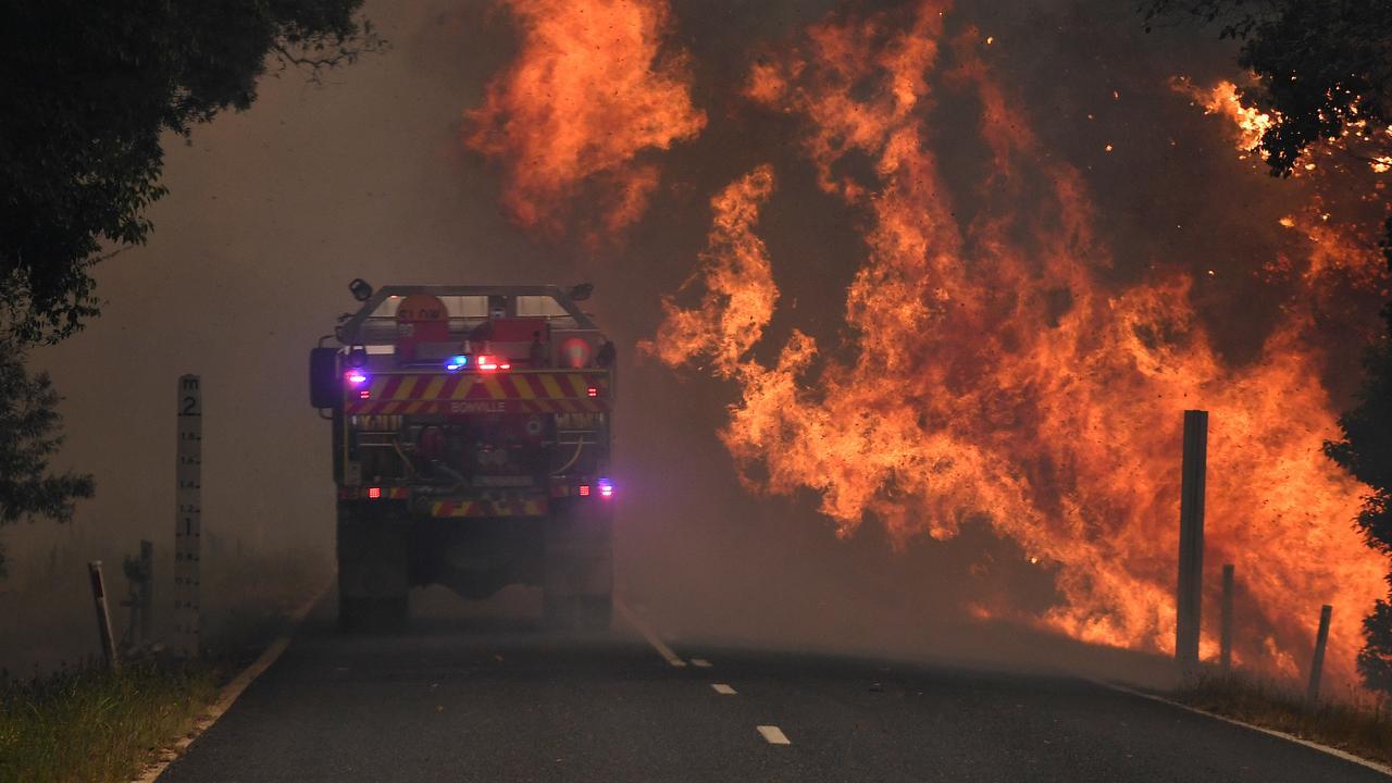 A fire truck is seen near a bushfire in Nana Glen in November 2019. (AAP Image/Dan Peled)