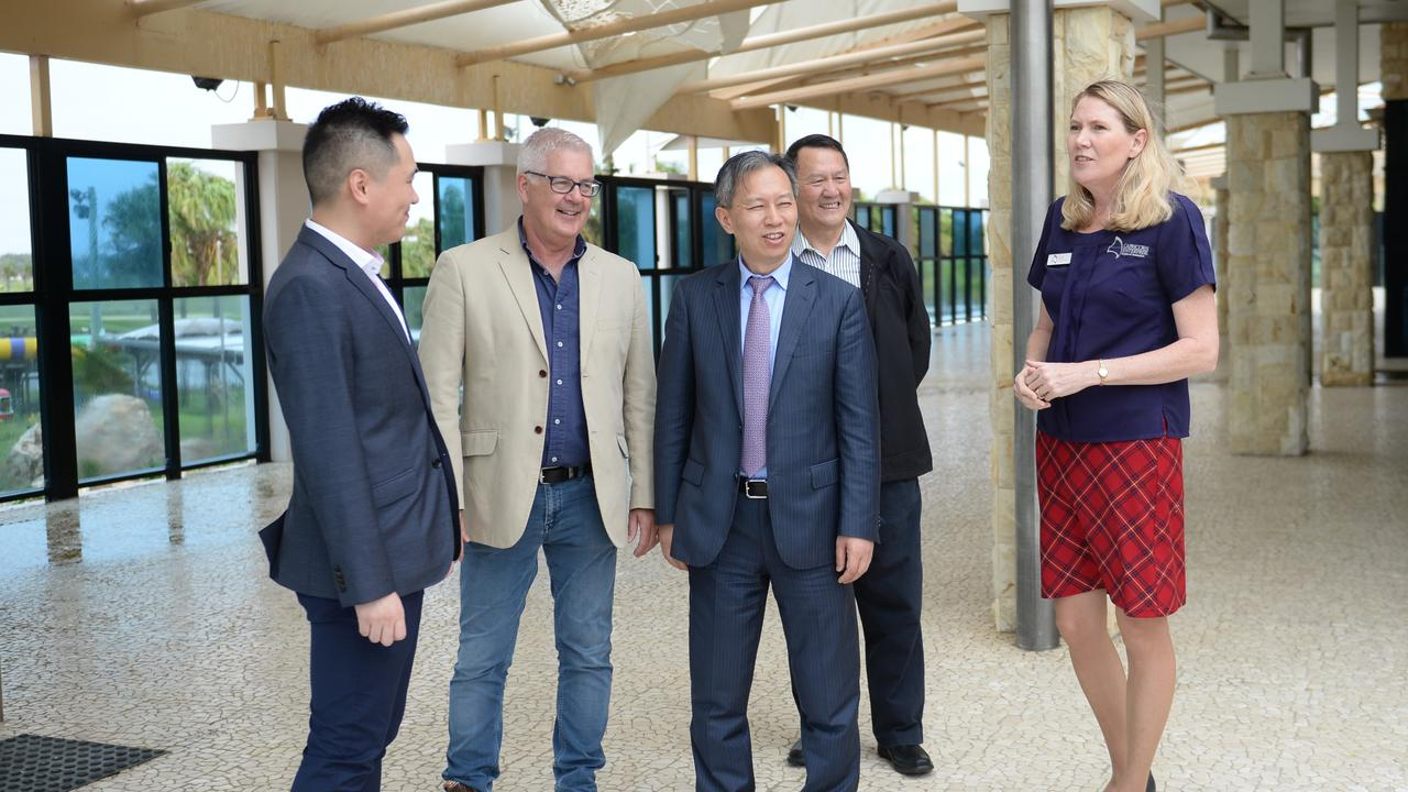 Interpreter is Dustin Yuan, Knight Frank Principal Pat O'Driscoll, Mr Ding Zuo Yong (Managing President Yuexing Group), a member of the Yuexing Group and Capricorn Enterprise CEO Mary Carroll.