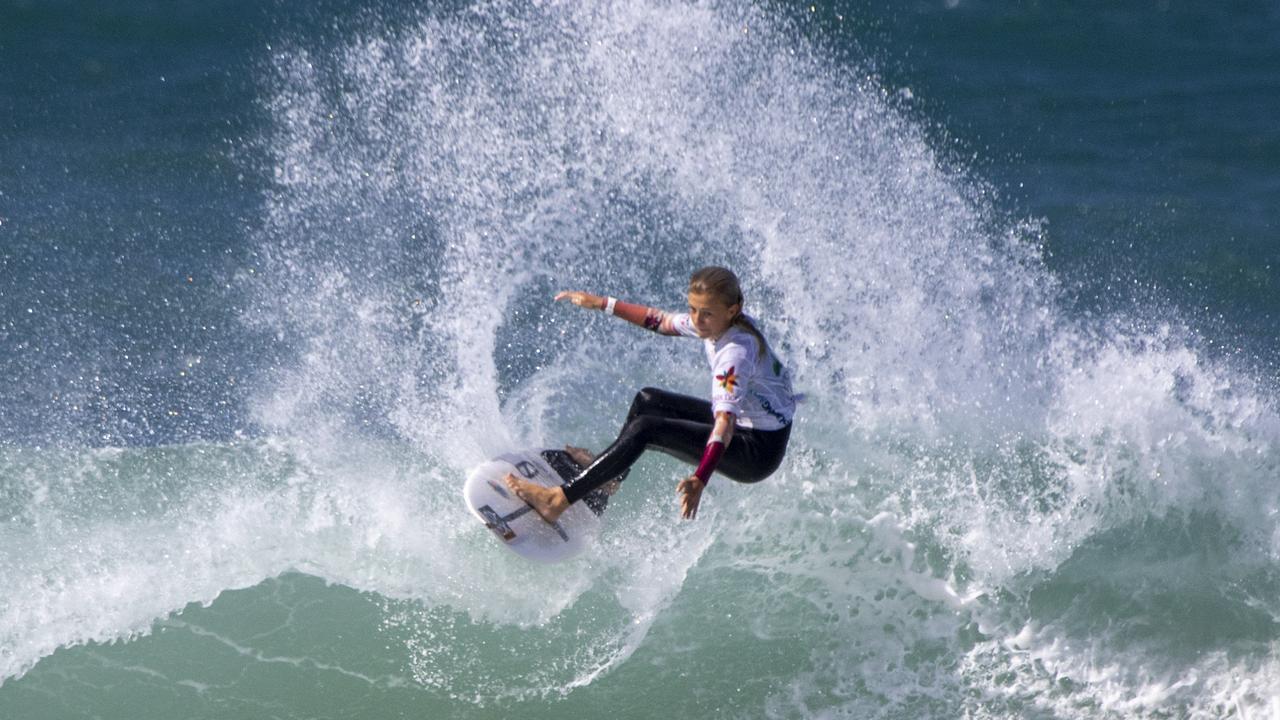 Rosie Smart rides to victory for Bishop Druitt College in the Under 16 NSW School Surfing Titles. Photo: Josh Brown