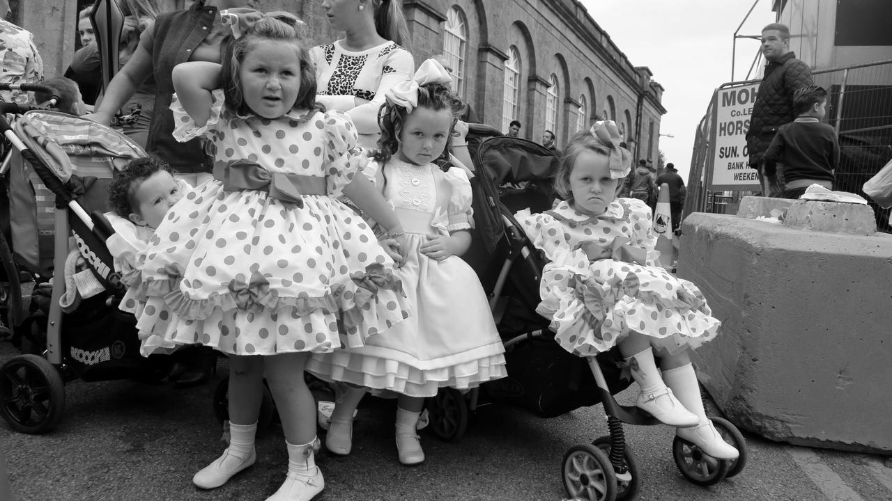 Three girls pose in their dresses. Picture: Jamie Johnson