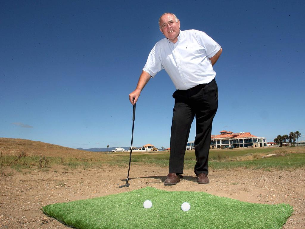 Director Chris Dadson with the new synthetic turf that will make up the new golf course in 2006. Pic Peter Wallis