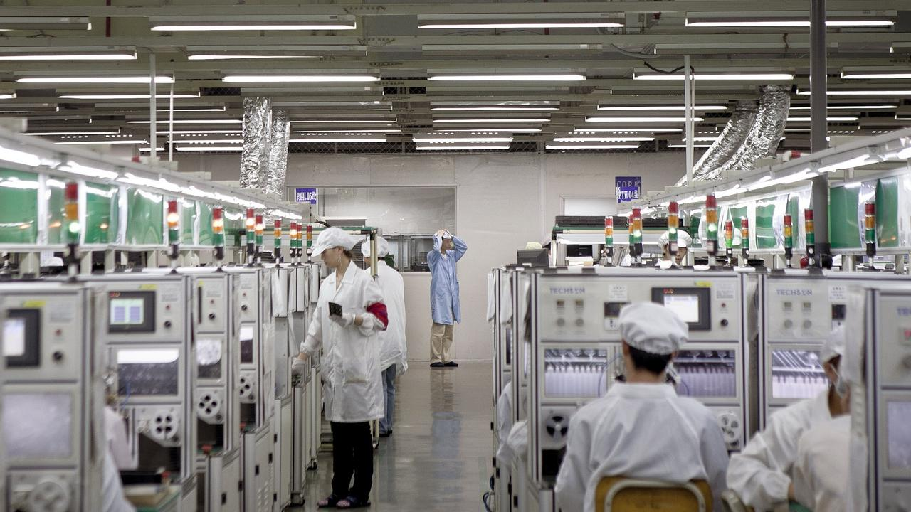 Foxconn workers on a production line in 2010. Picture: Thomas Lee/Bloomberg
