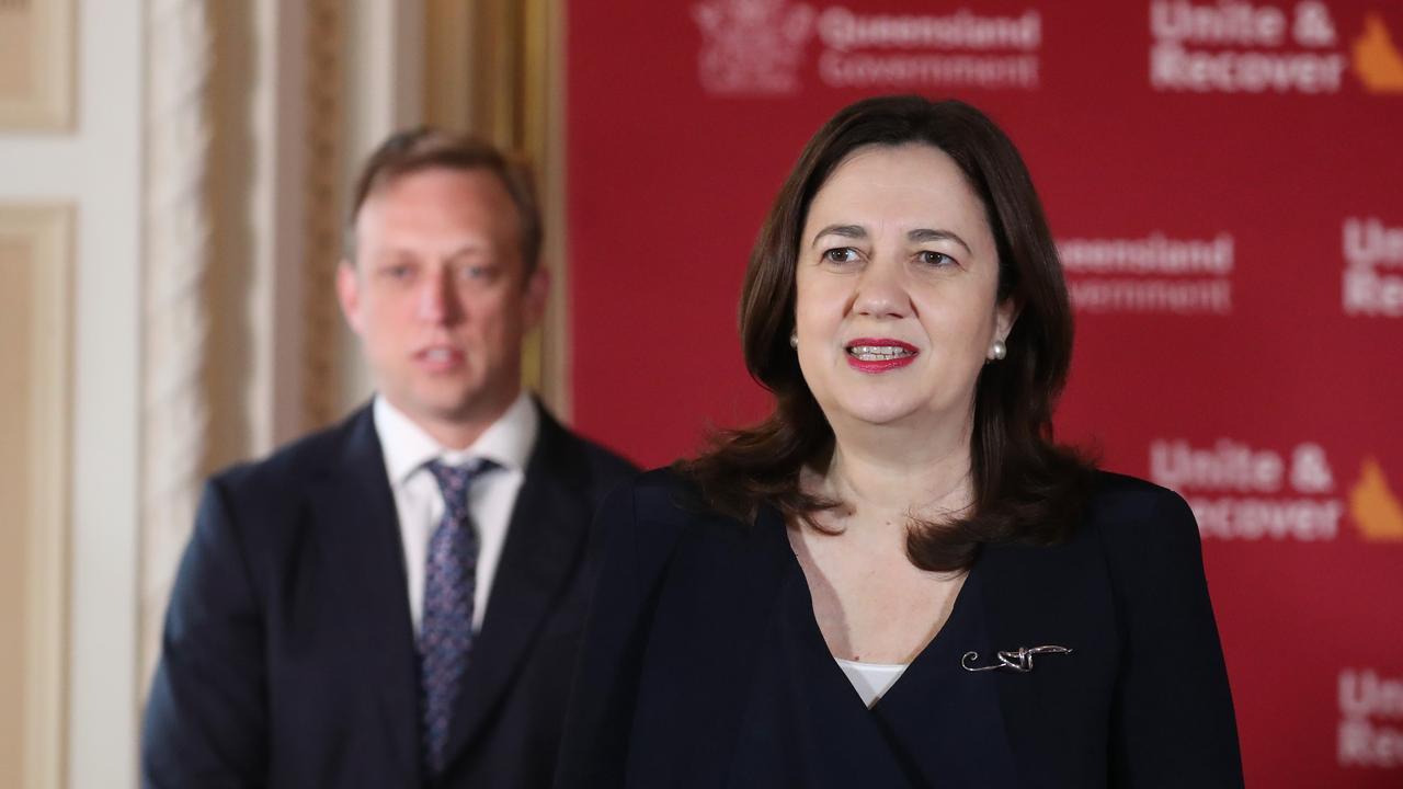 Premier Annastacia Palaszczuk, with Deputy Premier Steven Miles behind her. Picture: Annette Dew