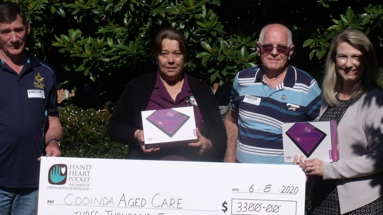 The Gympie Freemasons present Cooinda Aged Care with computer tablets to help them catch up with local news.