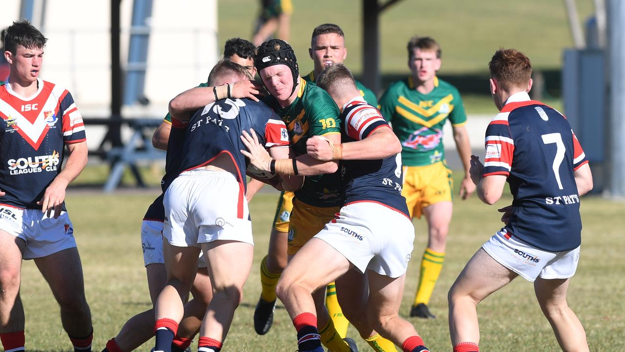 St Brendan's Grady Callaghan is wrapped up by some solid St Patrick's College defence in the Aaron Payne Cup clash at Yeppoon. Picture: Jann Houley