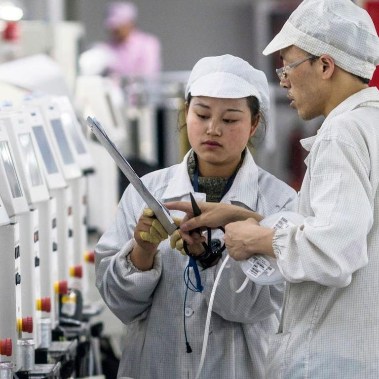 Foxconn workers at a factory in Guizhou Province, China, in 2018. Picture: Aleksandar Plavevskiepa/Shutterstock