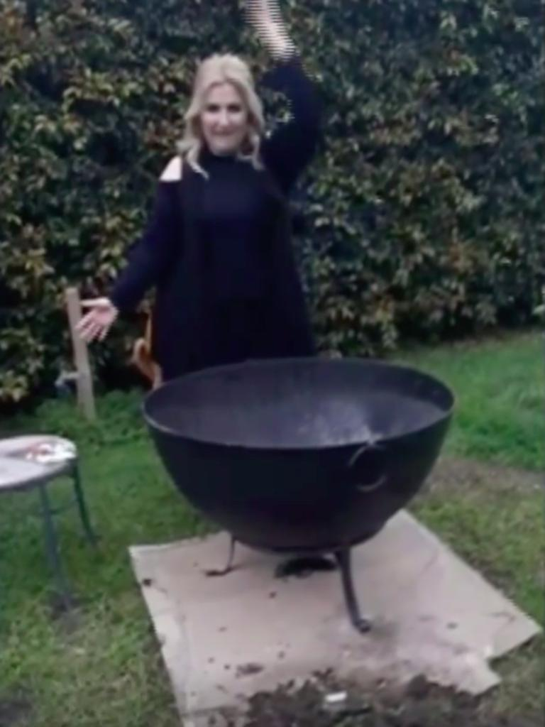 For anyone at home thinking Ms Rose is performing interpretative dance behind a large paella pan … you're mistaken. Picture: Supplied