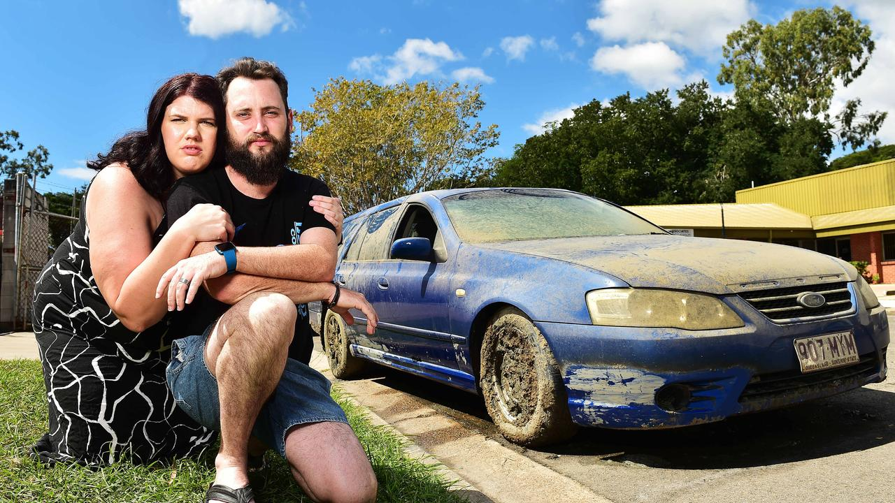 Corey Dawson and Seanne Breeding are the owners of the pictured car which was dumped in the Hyde Park lake after being stolen from their Gulliver home. Picture: Shae Beplate.