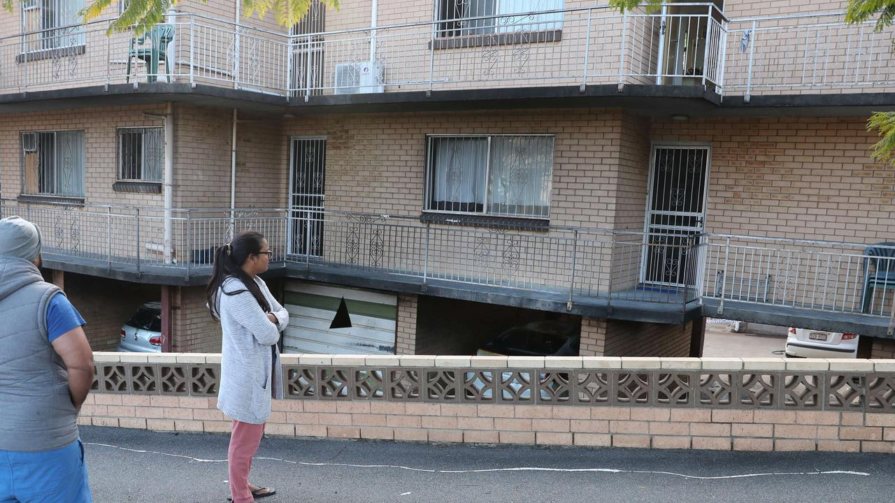 Residents inspect the fire damage in Highgate Hill. Picture: Peter Wallis
