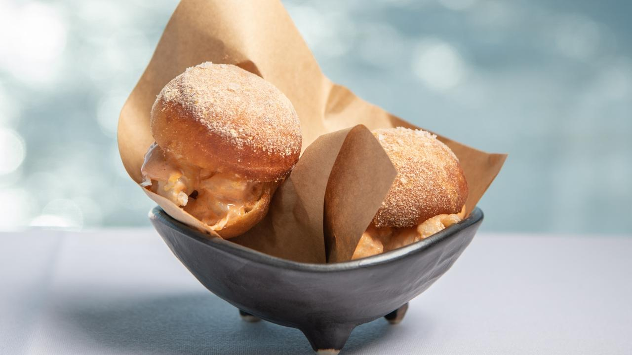 "The crab ""doughnut"" sliders with coral mayo. Picture: Brad Fleet"