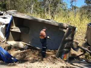 PHOTOS: Driver hospitalised as truck rolls near Gympie