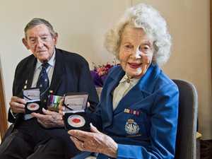 Joe and Barbara receive commemorative medallions