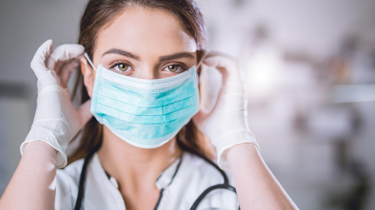 Female doctor with surgical mask on
