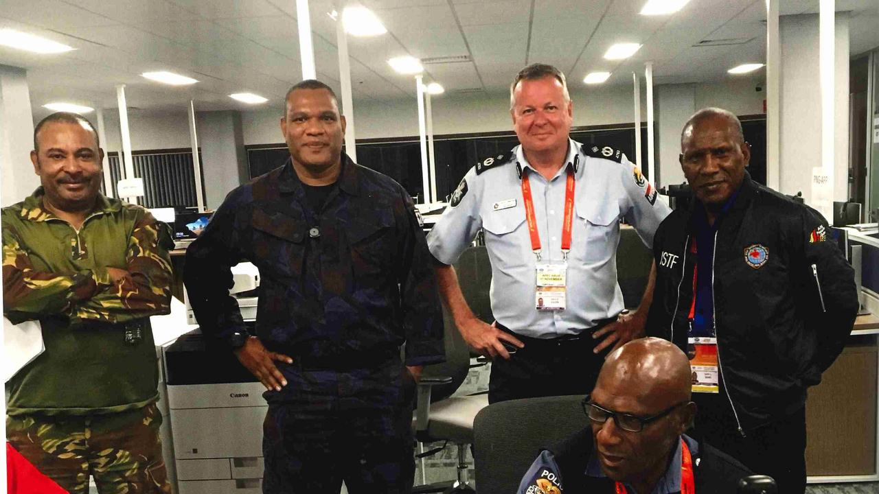 Assistant Commissioner Bruce Giles with RPNGC colleagues in 2018 at Port Moresby.