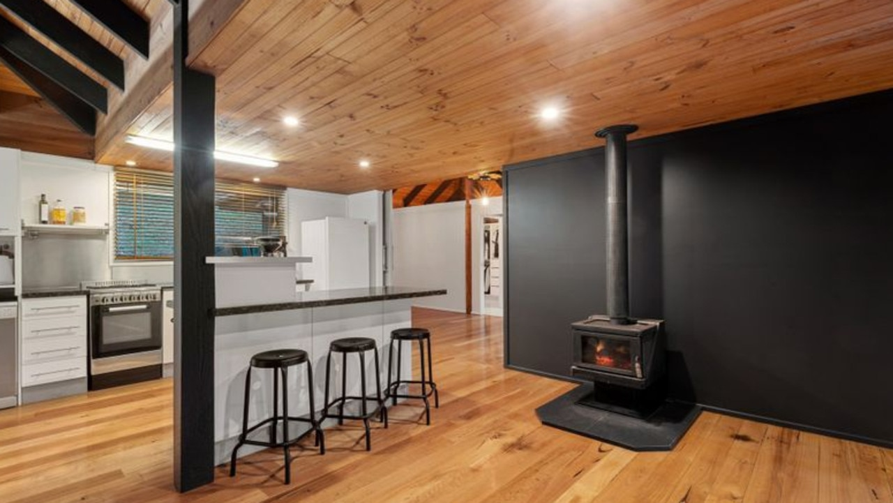 The kitchen and living area features a fireplace for those cool evenings.