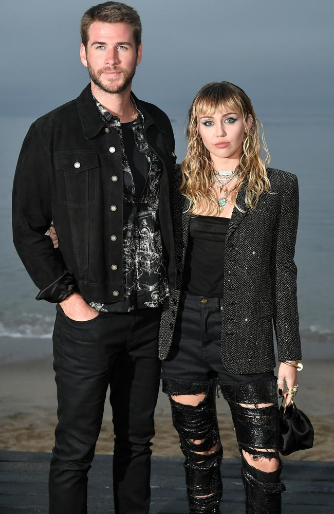 Liam Hemsworth and Miley Cyrus attend the Saint Laurent Mens Spring Summer 20 Show Photo Call in 2019 in Malibu, California. Picture: Getty
