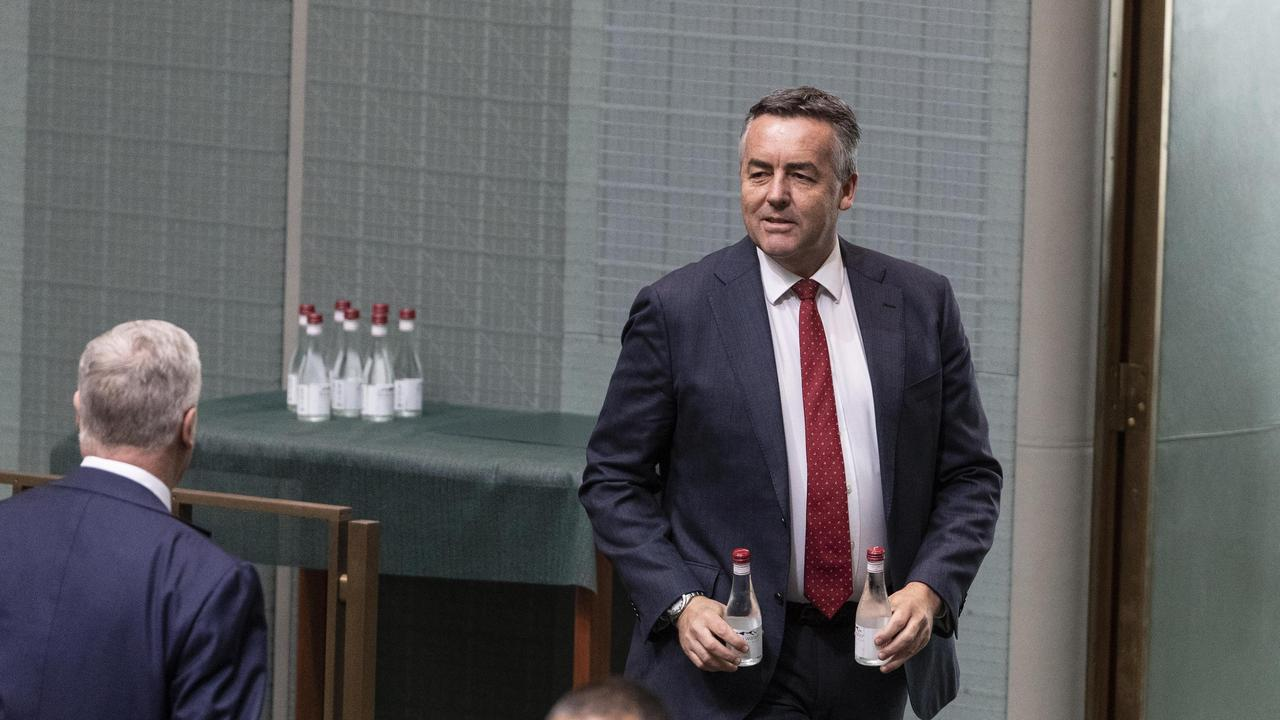 Darren Chester grabs two bottles of water for the PM. In response to the COVID19 virus a smaller group of Federal MPs were present in the chamber during Question Time in the House of Representatives at Parliament House in Canberra. Picture Gary Ramage