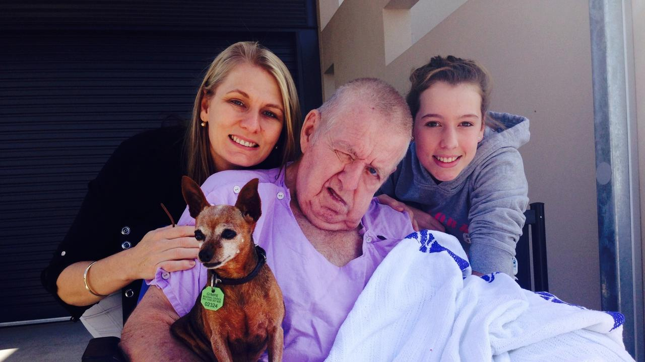 SUFFERING: Barry Langbecker with his daughter Denise Kapernick and granddaughter Emil and his dog Bonn - this was the last day Barry was able to be wheeled outside as he wasn't able to be hoisted into a wheelchair again because his pain levels were unmanageable. He needed top-ups of morphine so the nurses could clean him or tend to his bedsores. Even cutting his fingernails brought him to tears.