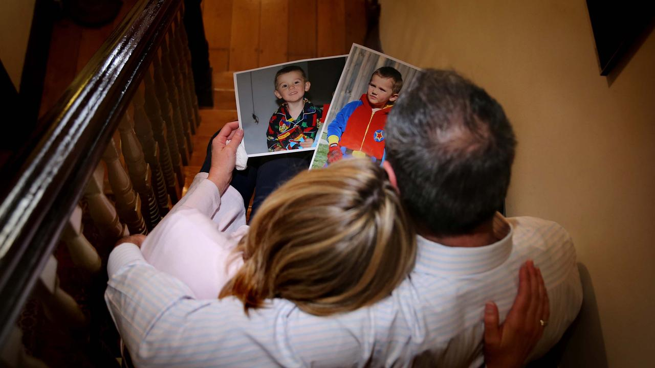 William Tyrrell's foster parents looking at pictures of their missing son in Sydney.