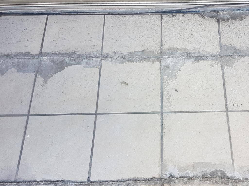 The tiles in this Newcastle building complex show substandard waterproofing.