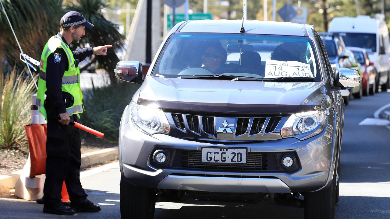 Police checking vehicles at a border checkpoint on Griffith Street at Coolangatta. Picture: Adam Head