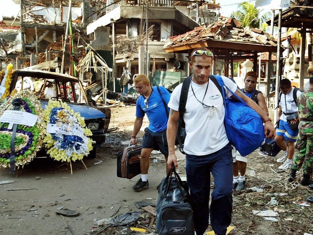 Tourists take refuge from area of ruins of the Sari nightclub. Picture: Supplied