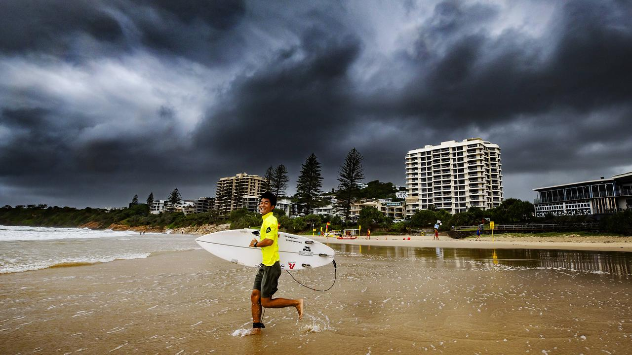 FILE PHOTO: Shoma Nishimura runs out under an approaching storm front at Coolum. Photo: Lachie Millard