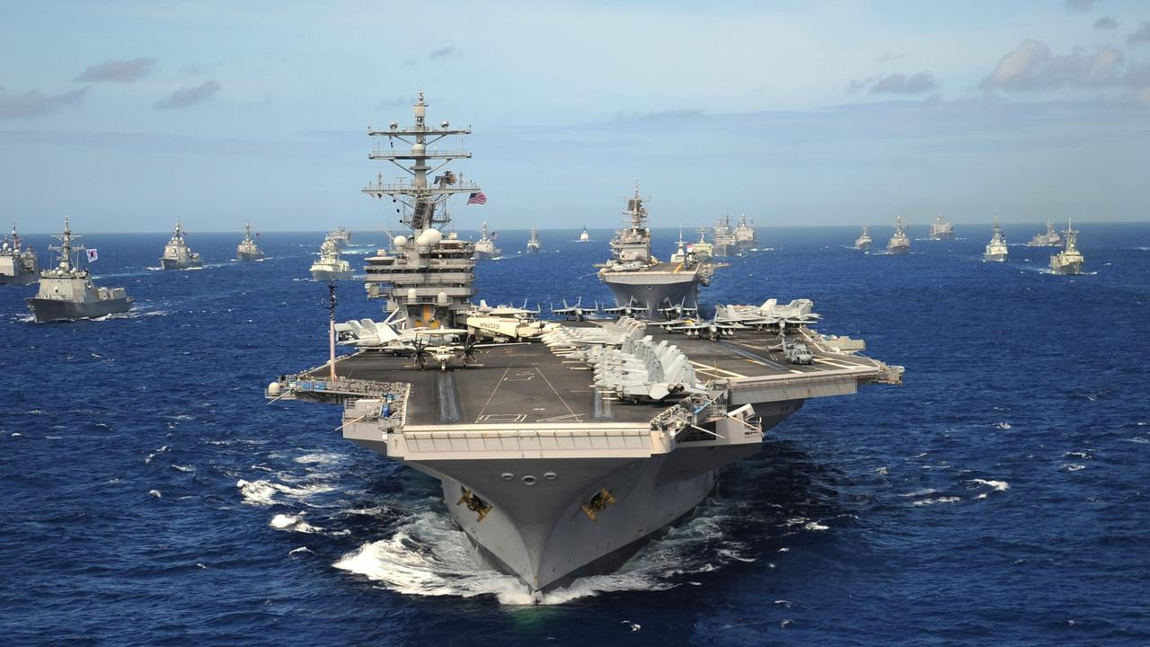 D4NHD2 US Navy Nimitz-class nuclear aircraft carrier USS Ronald Reagan leads a group of multinational ships during RIMPAC exercises July 24, 2010 in the Pacific Ocean.