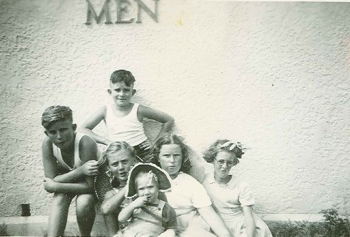 STEP BACK IN TIME: Brothers Ted (back) and (front from left) Ron Watson, Yvonne and Kerris McLean, Mary Highland and Joan Pazzi in front of the new toilet block built at Burnett Heads after a cyclone razed the town's outhouses in 1949. Photo: The McLean Family Album
