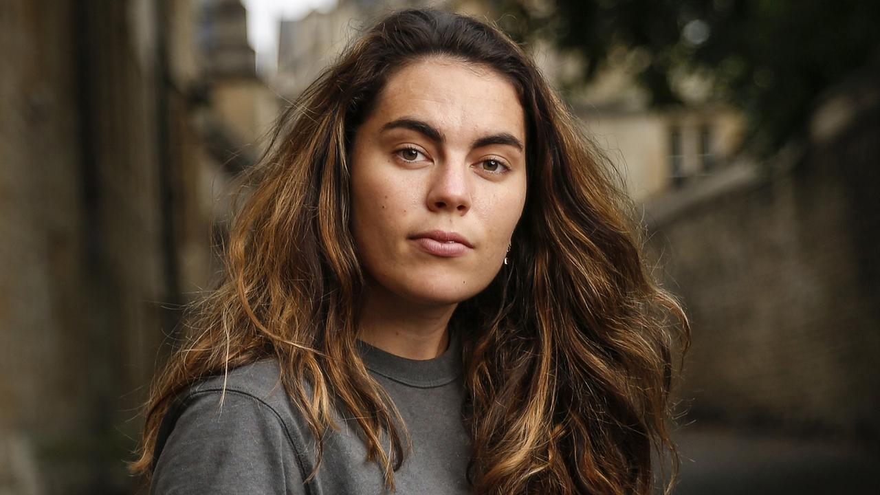 Sophie Rose, 22, originally from Brisbane, in Oxford, U.K. She was photographed without a mask while following social distancing rules. She is advocating for human challenge trials on coronavirus vaccine candidates. Photo: Hollie Adams