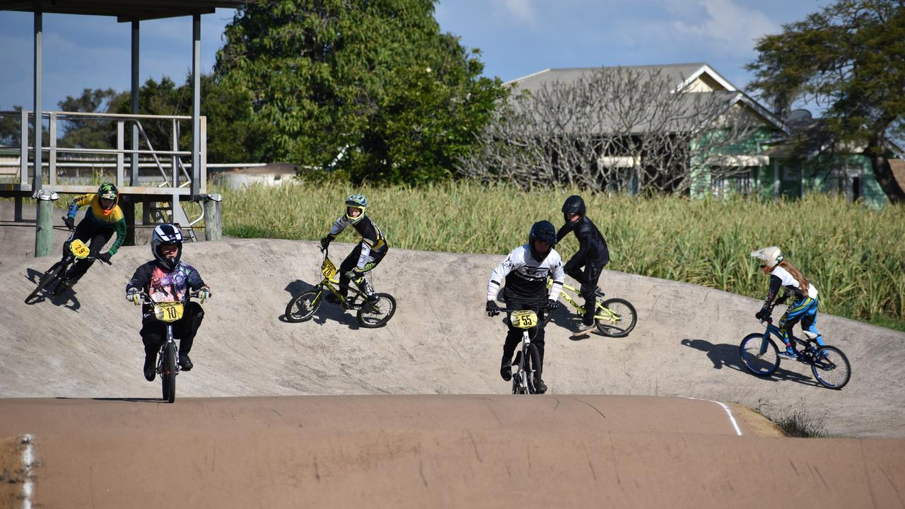 BMX: Riders turn into the final stretch of the track during a practice ride. Photo: Stuart Fast