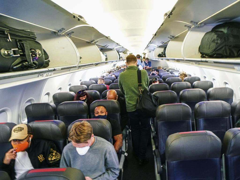 Masked passengers and spare seats. Domestic flights have changed in ways that nobody saw coming. Picture: Sandy Huffaker/Getty Images