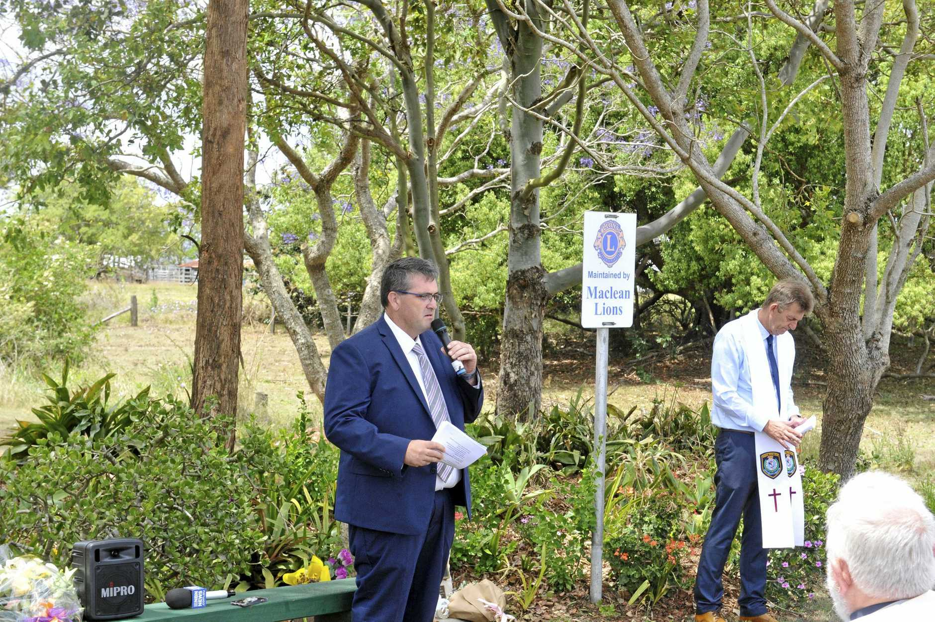 Councillor Richie Williamson reads the names of the victims of the Cowper bus crash before a minutes silence.
