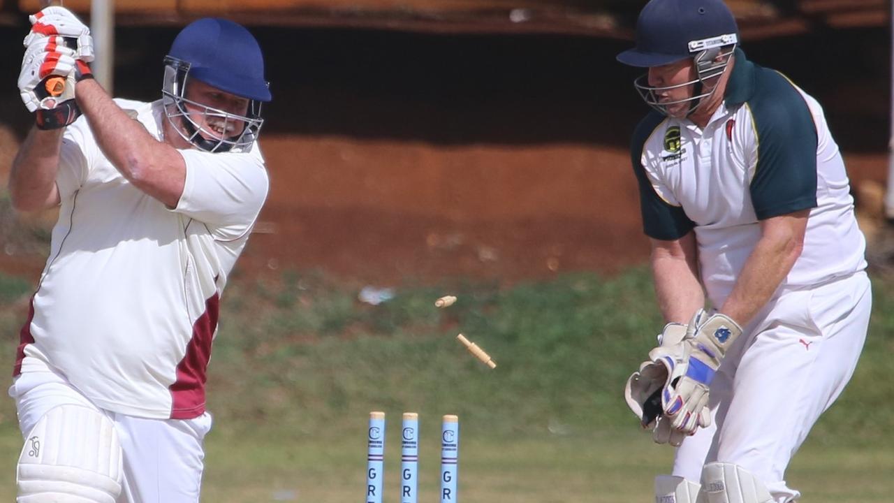 Bob Cochran is bowled by Lockyer/Ipswich cricketer Graham Bichel.