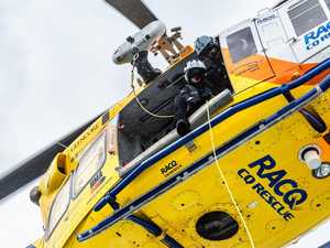 Rescue chopper winches hurt mountain hiker to safety