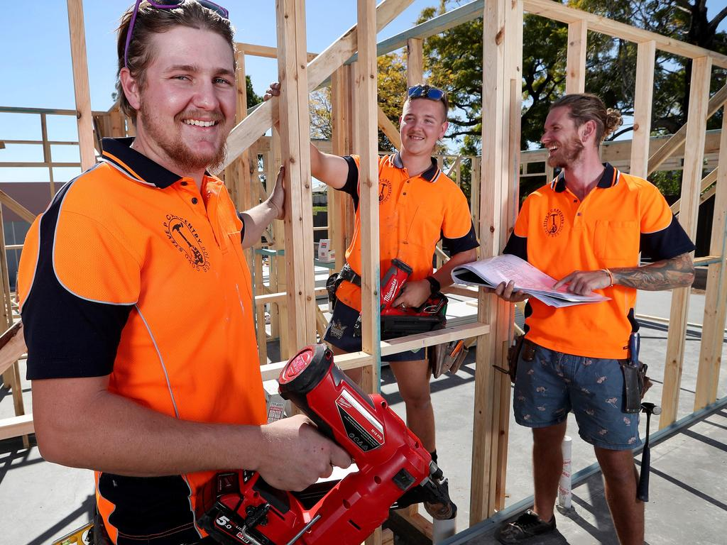 TAFE Queensland carpentry apprentices Ethan Sutherland and Karl Van Rijssen with apprentice manager Steve Purcell working on a 54-townhouse development at Richlands. Picture: Tara Croser.