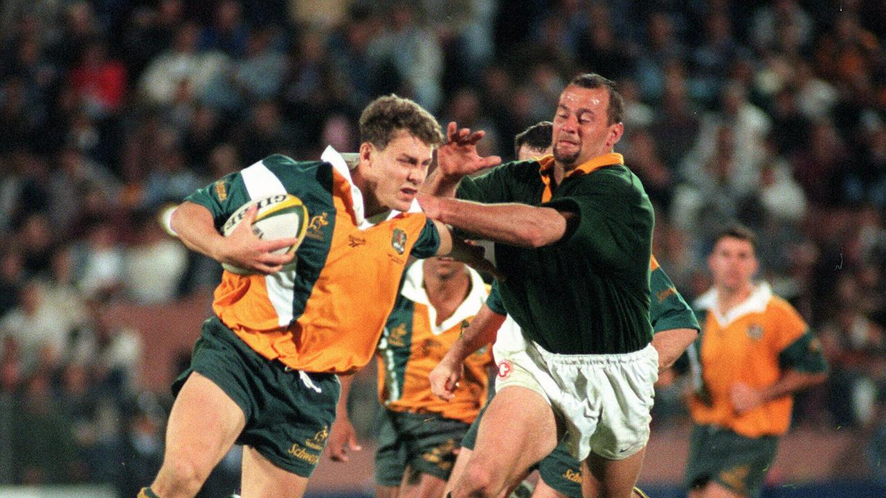 TGS old boy Jason Little defends the ball in an Australia v South Africa, Tri-Nations Test at Suncorp Stadium in 1997.