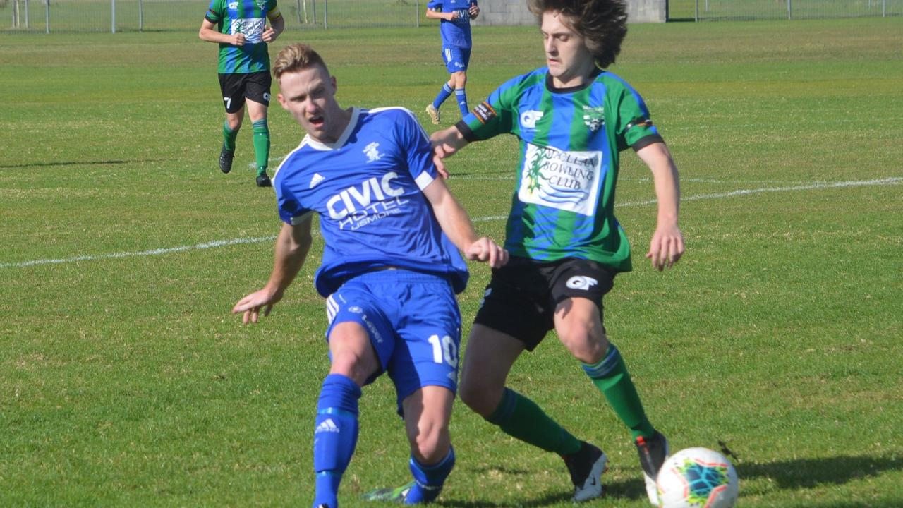 THISTLES STING BOBCATS: In an exciting match, experienced Thistles defender Jeremy Sullivan gets the better from Maclean Bobcats striker Fraser Marsh. Photo by Steve Mackney