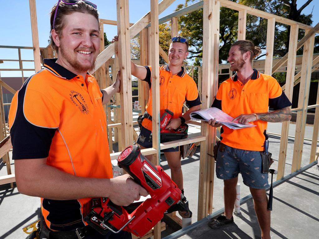 TAFE carpentry apprentices Ethan Sutherland and Karl Van Rijssen with apprentice manager Steve Purcell working on a 54-townhouse development at Richlands. Picture: Tara Croser