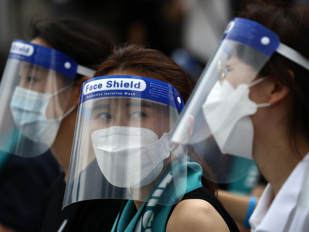 Doctors wearing face protective equipment as a preventive measure against the coronavirus (COVID-19) attend a rally against the government medical plan on August 14. Picture: Chung Sung-Jun