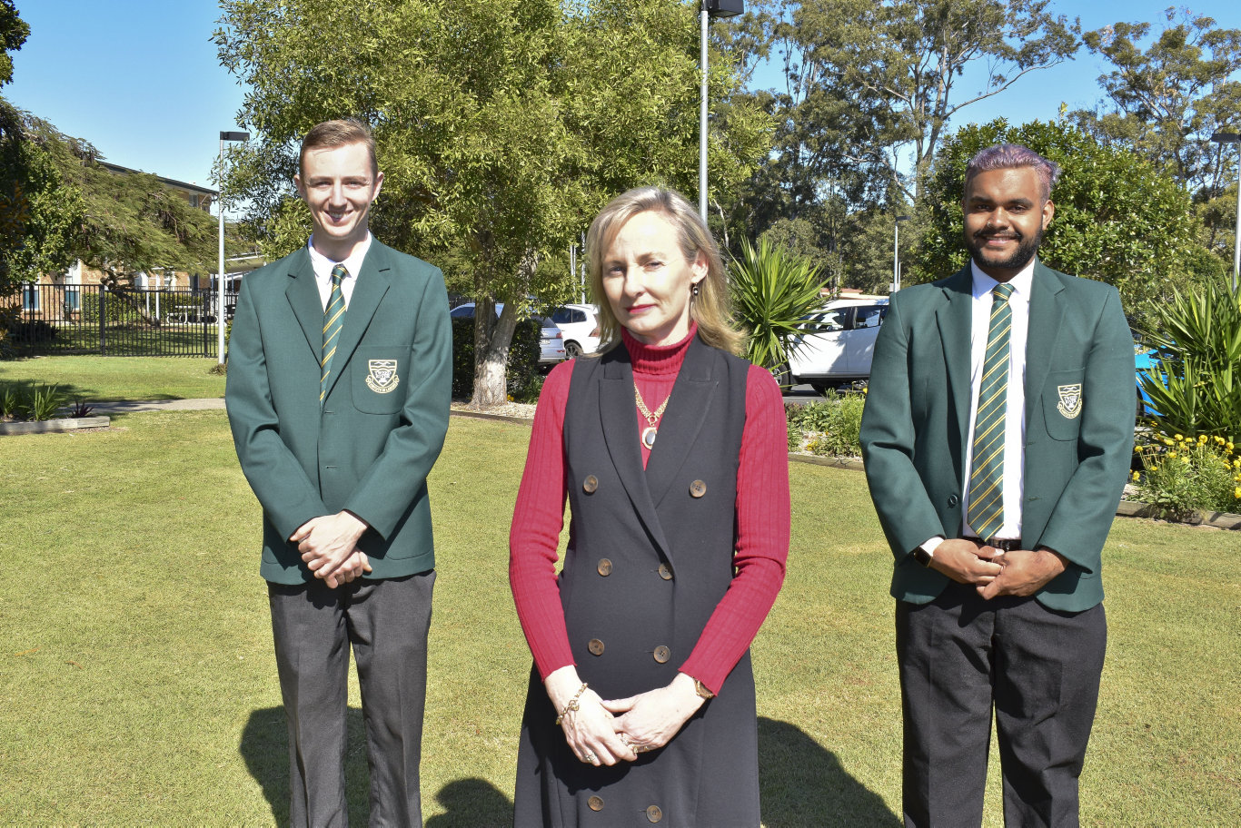 Vice captain Adam Lewis, 17, principal Leisa Conroy and school captain Rubin Duroux, 17, at the announcement of the $17 million commitment to upgrade the Tweed River High School to include specialist vocational education facilities. Photo: Jessica Lamb