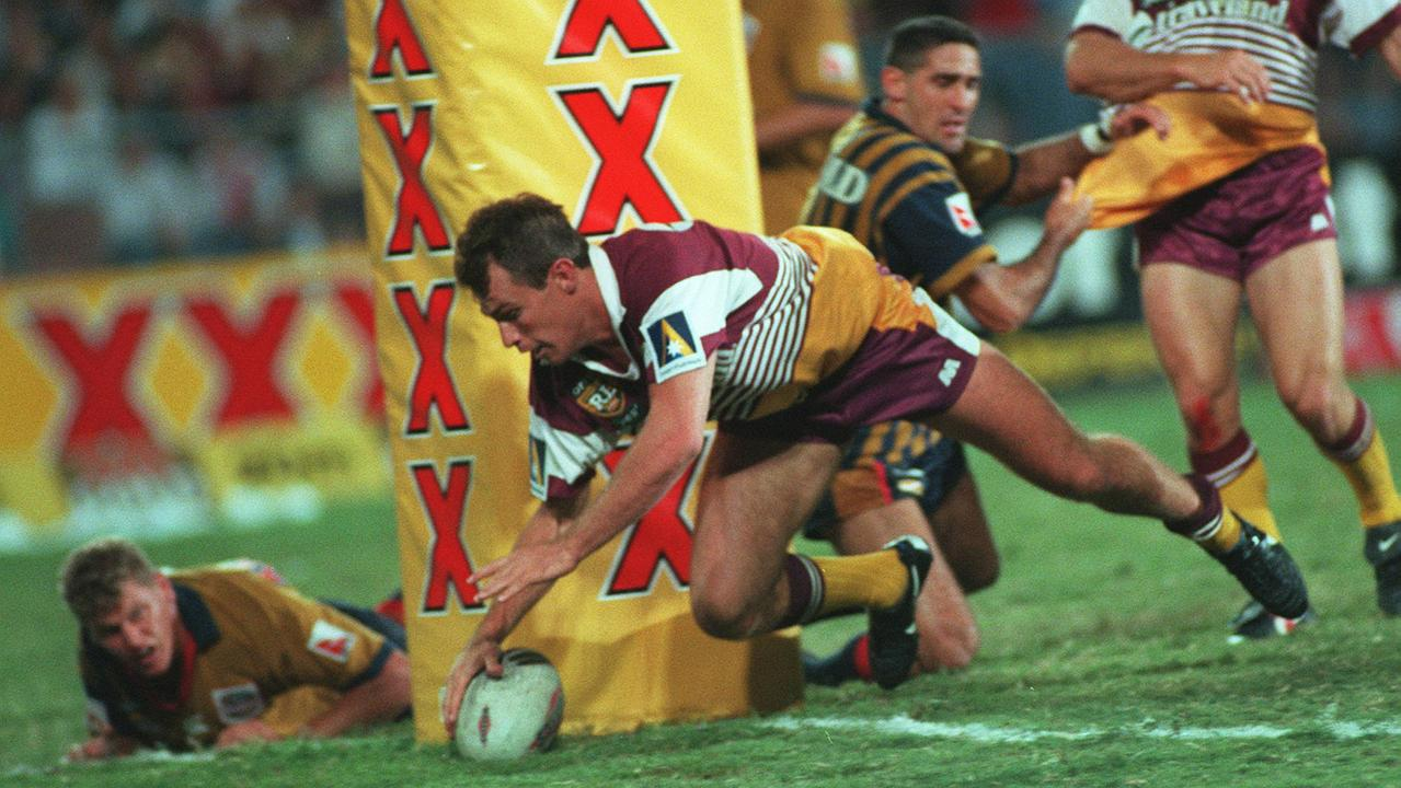 Willie Carne dives over to score for the Broncos against the South Queensland Crushers in 1996.