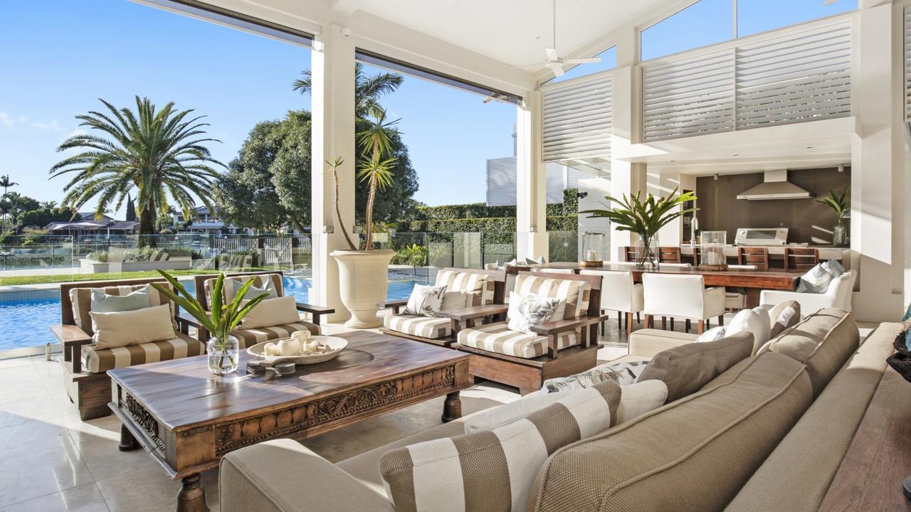 Photos show the home's deluxe interior.