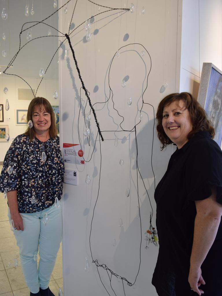 Emerald artists Michelle Gray and Raelene Bock with their piece 'Girl in the Rain'.