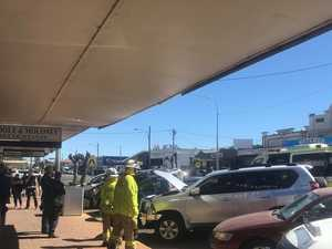 Paramedics assessing patients after Kingaroy shop crash