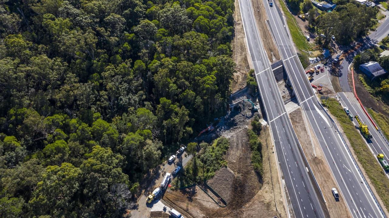 Work to bring the old Pacific Highway overpass near Townsend down now that Maclean Interchange has opened.