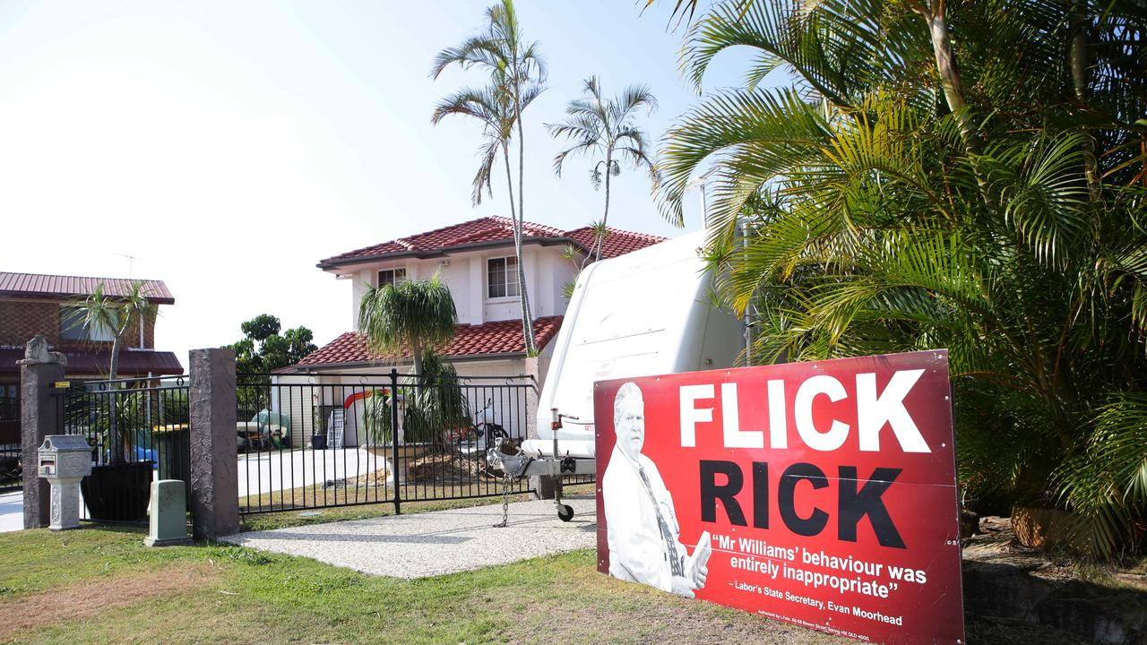 Signs out the front of Rick Williams neighbours home at Banksia Beach. Picture: Ric Frearson