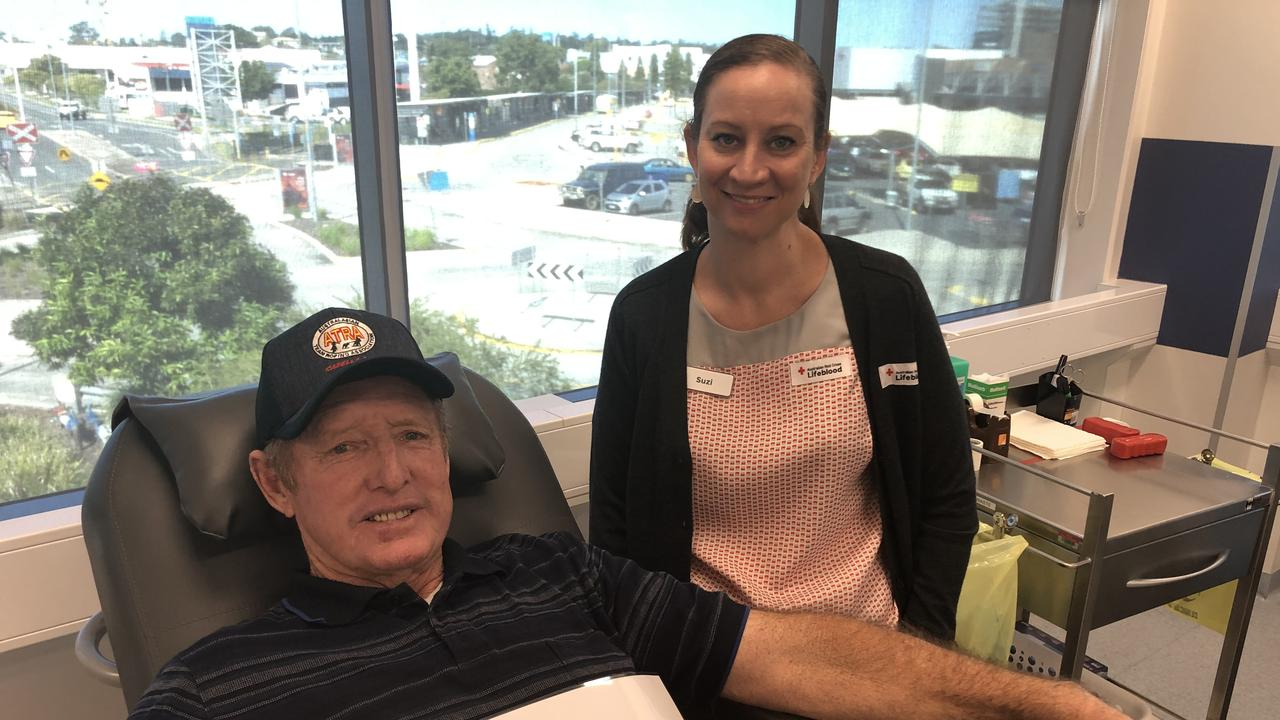 Allan Knox donates blood with the help of Red Cross Lifeblood worker Suzi.