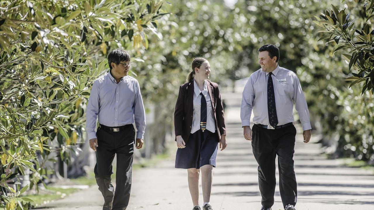 Aviation lecturer Dr Paul Lee, Year 12 student Madeline Higgins and St Augustine school principal Graham Meertens.