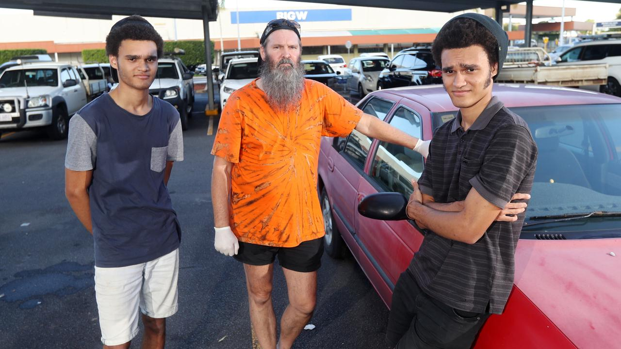 Earlville resident Grant Richards said he and his sons were racially profiled as car thieves at Stockland because they wore gloves in the car park to be COVID safe. Grant Richardson, centre and his sons Ray and Brendon with their car at Stokland shopping centre. PICTURE: STEWART McLEAN
